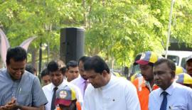 Minister of Media and Chief Government Whip Gayantha Karunathilake operates a road marking machine to change the colour of the Zebra Crossing white.