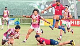Havies winger Chamara Dabare (with ball in hand) about to sling out a pass to his team mate Sudarshana Muthuthantri in the Dialog 'A' division rugby league match against CR&FC at Longden Place yesterday. (Pic Thilak Perera)