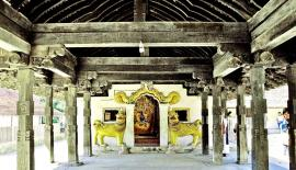 The interior of the Digge (Dancing Hall) of the shrine adorned with elegant designs of wood carvers of centuries ago of Embekke Devale