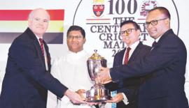 Asela Herath (OACW)  and  Nilantha  Ratnayake ( President Trinity CF) handing over the  John Halangoda  Challenge  Trophy to  the two   principals Andrew Fowler- Watts (Trinity) and Rev.  Fr. Henry  Bernard  Wijeratne ( SACK)