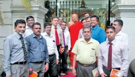 SLI representatives, with Chief Incumbent of the Gangarama temple  Ven. Galaboda Gnanissara Thera