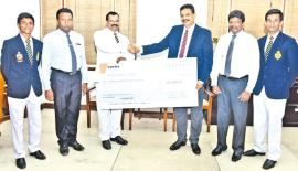 A Certis official presents the sponsorship to check to Royal College principal