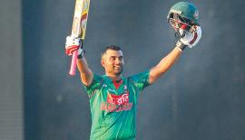 Bangladesh opener Tamim Iqbal celebrates his eighth century in the first ODI against Sri Lanka at the Rangiri Dambulla Stadium yesterday. PIc by Rukmal Gamage