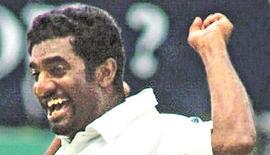 AFP PHOTO/  Sena VIDANAGAMA Sri Lankan off spinner Muttiah Muralitharan celebrates claming his 500th Test wicket at the Asgiriya stadium