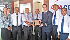 The representatives of the Sri Lanka Ports Authority, CICT and  CMA CGM Lanka at the traditional plaque exchange ceremony on board  the Nabucco.