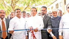 President Maithripala Sirisena opens the block of Oddamavadi Central College. Education Minister Akila Viraj Kariyawasam, Eastern Province Chief Minister Ahmed Nazeer Zainulabdeen and officials look on.