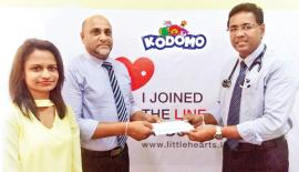 Managing Director of UTN Trading Company,  Udaya Nissanka presents the confirmation letter of  Kodomo sponsorship to Dr. Duminda Samarasinghe, Consultant Pediatric Cardiologist, representing the Cardiology team at the Lady Ridgeway Hospital.