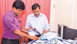 Pramod de Silva (Consultant Editor, Sunday Observer) and Chaminda Perera (News Editor , Daily News) picking the lucky reader's coupon at the 13th week's count. Three cornered tussle for top spot. Pic. Chaminda Niroshan