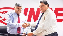 Chairman of National Apprentice and Industrial Training Authority, Dr. A.U.C. Athukorala exchanging the agreement with CEO of Insee Cement, Nandana Ekanayake (on left).