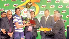 Vinul Fernando Captain of St. Joseph's College receiving the Millo President's Trophy from Minster of Education Akila Viraj Kariyawasam after beating Isipathana College 19-13 at the final. Royal College Principal B.A. Abeyratne and other officials are also in the picture.   (Picture Tilak Perera)