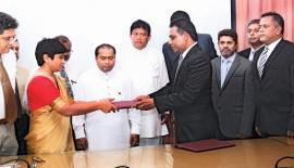 The exchange of the agreement. From left: Chairperson, Waste Management Authority, Western Province, Ms. Ruwini Dharmasiri, Chief Minister, Western Province, Isura Devapriya and Group Chief Executive Officer, Fairway Holdings, Imal Fonseka.