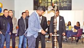 President of the SACOBA, Melbourne Manjula Munasinghe lights the traditional oil   lamp while the members of the Association look on.