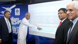 State Minister of Finance, Eran Wickramaratne switches on the Customs' electronic payment platform. Central Bank Governor, Dr. Indrajit Coomaraswamy, LankaClear, Chairman Anil Amarasuriya and Customs chief Chulananda Perera look on. PICTURE BY RUWAN DE SILVA
