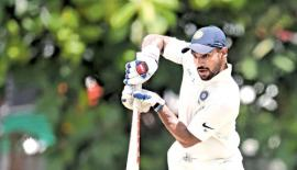Indian batsman Shikhar Dhawan plays down a delivery during  his knock of 41 off 48 balls on the second day of the two-day practice  match against an SLC President's XI at the CCC grounds yesterday. AFP