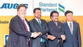 Chief Executive Officer of Standard Chartered Sri Lanka, Jim McCabe, Chairman, Laugfs Holdings, W.K.H. Wegapitiya, Group Managing Director of Laugfs Holdings, Thilak de Silva and Deputy General Manager of SINOSURE, Guo Yilin at the ceremony.