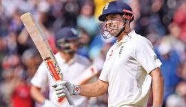 England's Alastair Cook celebrates reaching 200 during play on day 2 of the first Test cricket match between England and the West Indies at Edgbaston in Birmingham, central England on August 18. AFP