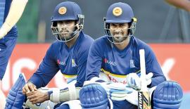 Angelo Mathews and Upul Tharanga await their batting turns during practice at the Rangiri Dambulla Stadium ahead of the first ODI against India on Sunday. – AFP