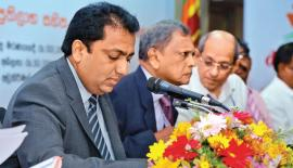 Education Minister Akila Viraj Kariyawasam and Sri Lanka Insurance Chairman Hemaka Amarasuriya at the media briefing.