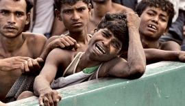 Rohingya Muslim refugees fleeing Burmese military operations swell to nearly half a million.