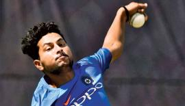 India's Kuldeep Yadav bowls during a practice session - AFP