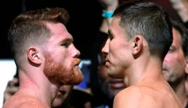 Boxers Canelo Alvarez (L) and Gennady Golovkin (R) face-off during their weigh-in at the MGM Grand Hotel & Casino on September 15, 2017 in Las Vegas, Nevada. Alvarez will challenge WBC, WBA and IBF middleweight champion Gennady Golovkin for his titles at T-Mobile Arena on September 16th in Las Vegas.  AFP PHOTO / John GURZINSKI