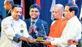 Chef Dimuthu receiving his award from President Maithripala Sirisena.