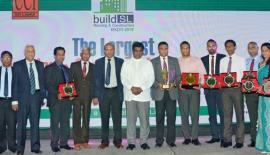 The sponsors with their tokens of appreciation with  Deputy Minister Ajith  P. Perera.