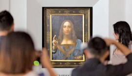 People take photos of Leonardo da Vinci's Salvator Mundi painting. Pic: Jerome Favre/EPA