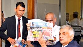 Prime Minister Ranil Wickremesinghe challenged the newspaper editors who had carried misleading reports