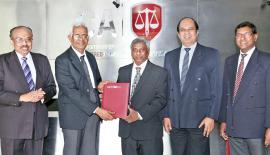 BRIPASL Chairman Dr. J.M.Swaminathan exchanging the agreement with CA Sri Lanka President Lasantha Wickremasinghe. Also in the picture are BRIPASL Secretary K.Neelakandan and CA Sri Lanka's Past President and Chairman of the Sub Committee on Capacity Building for Corporate Insolvency Services Arjuna Herath and CA Chief Executive Officer Aruna Alwis.
