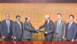 Representatives of Commercial Bank and UnionPay at the signing of the agreement between the two companies