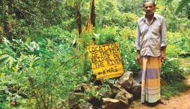 FOND MEMORIES: Samuel Perera with  his hand written signpost