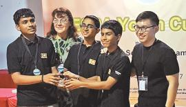 Youth Scrabble team receiving the trophy