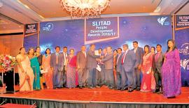 Lake House, General Manager Abhaya Amaradasa, Deputy General Manager, (Human Capital) Narada Sumanaratne and members of the Human Capital team of Lake House with the SLTAD People's Award.