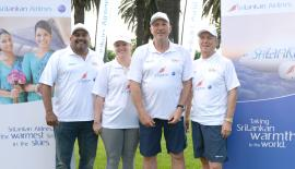 SriLankan Airlines, Manager Australia Sanjeeva Jayatileke with Sir Ian Botham and the team members.