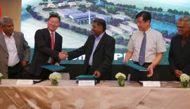 Sri Lankan and Chinese officials exchange documents following the signing of the agreement at an event held to announce the commissioning of the dendro power plant in September.