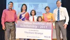 Managing Director, Allianz Insurance Lanka, Mrs. Surekha Alles (second from left) and  GM, Sales and Distribution, Allianz Life Insurance Lanka Ltd., Nihal Hadunge with Theshani Hiranya and her family members.
