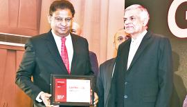 Managing Director,  LB Finance, J. A. S. Sumith Adhihetty receives the award from Prime Minister Ranil Wickremesinghe