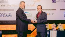 Head of Islamic Banking, Hisham Ally receives the award from Chief Executive Officer, ADL Capital, Ishrath Rauf.