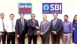 (From left) Head of Certification and Integration LankaClear Hemanthe Samaliarachchi, Head of External Services LankaClear Isuru Jayaweera, DGM IT & Operations LankaClear Dinuka Perera, GM/CEO LankaClear Channa de Silva, Country Head SBI Rajeev Srivastava, SVP Branch Head, Colombo Hemant Jaiswal,Vinoth and Taniya IT team SBI Sri Lanka
