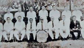Standing from lef: F.A. Fernando, A.T. Fonseka,V. Narendra, M. Guneratne, F. Burke, M. Siriwardene D. Rajaratnam (seated from left) H.C. Perera, N. Weerasinghe, F. Perumal, B.A. Jayasinghe (President GSCA) Minister of Health E.L. SenanayakeE. L. Abeygunewardene (IGP), T.B. Werapitiya, S. Kuruppu (Secretary GSCA), D. Weerasinghe, T.B. Kehelgamuwa