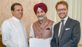 High Commissioner of India Taranjit Singh Sandhu and Ambassador of France Jean-Marin Schuh present the invitation to President Sirisena.