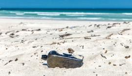 The bottle found in Western Australia had a message that noted the ship's coordinates and name, plus the date it was thrown into the sea.  Pic: Kym Illman.com