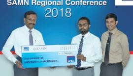 LOLC Group Managing Director/CEO, Kapila Jayawardena presents the cheque for the gold sponsorship to President, Lanka Microfinance Practitioners Association, Imran Nafeer and Manager, Lanka Microfinance Practitioners Association, Yasitha Munasinghe.