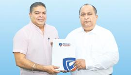 Mobitel Chief Executive Officer Nalin Perera exchanges the partnership agreement with People's Insurance Chief Executive Officer Deepal Abeysekara.