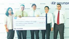 Julian Reuter –Director of Hyundai Lanka donating the cheque to Divakar Ratnadurai - National Director at SOS Children's Villages Sri Lanka, Flanked by SujithPieris - Director – Strategic Business Development and Sirhan Fernando, Head of Marketing at Hyundai Lanka (Right) and Hasangika Fernando Assistant Director Fund Development & Communications at SOS Children's Villages Sri Lanka (Left)