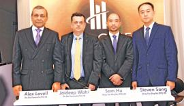 From left: Alex Lovell and Jaideep Wahi of The One Transworks (Pvt) Ltd and Sam Hu, and Steven Song of Zhong Tian Ding Hui (Pvt) Ltd., at the launch.