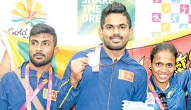 Chathuranga Lakmal (bronze- weightlifting), Indika Dissanayake (silver-weightlifting) and  Dinusha Gomes (bronze- weightlifting)