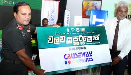 Colonel MAAD Sirinaga (left) accepts a sponsorship from Nirmal Hettiarachchie the Sales Manager of Causeway Paints in connection with the Walawa Super Cross  Picture by Tilak Perera