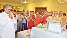 Minister Sarath Fonseka pays homage at the BMICH